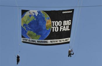 Greenpeace Banner: Earth, Too Big To Fail.